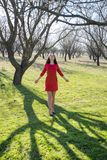 Young woman in a neglected almond orchard Royalty Free Stock Images