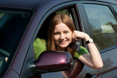 The young woman with the new car Royalty Free Stock Photography