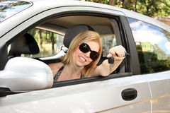 Young woman with  in new car Royalty Free Stock Photo