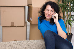Young woman in the new home using a mobile phone Stock Image