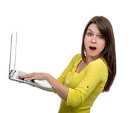 Young woman with new modern popular laptop keyboard with blank s Royalty Free Stock Photography