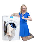 Young woman and  new washing machine Royalty Free Stock Images