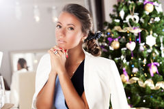 Young woman in a new year party. Holidays and celebration concept Stock Images