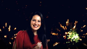 Young woman with new year's fireworks Royalty Free Stock Photos