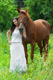 Young woman next horse Royalty Free Stock Photography