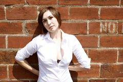 Young woman next to brick wall Stock Photos