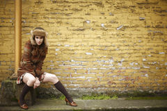 Young woman next to brick wall Stock Photography