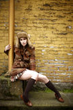 Young woman next to brick wall Royalty Free Stock Images