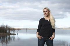 Young woman next to lake Stock Image