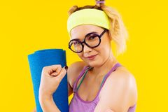 Young woman with nice hairstyle showing her arm muscles. Arm muscles. Young woman with nice hairstyle feeling good while showing her arm muscles royalty free stock photo