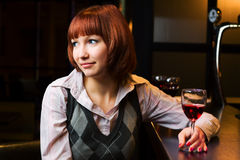 Young woman in a night bar Stock Image
