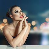 Young woman in night city Royalty Free Stock Image