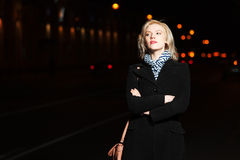 Young woman on the night city street Royalty Free Stock Images