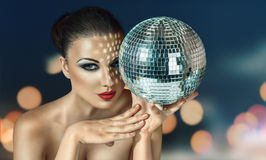 Young woman at night disco club. Young beautiful woman at night disco club Stock Photo