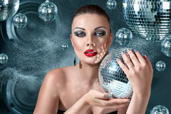 Young woman at night disco club. Young blonde woman at night disco club Stock Photo