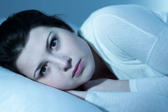 Young woman in the night. Young woman is thinking about something in the night Stock Photo