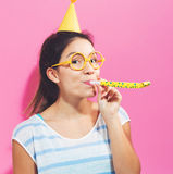 Young woman with noisemaker Royalty Free Stock Photo
