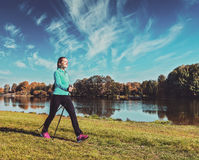 Young woman nordic walking Royalty Free Stock Photos