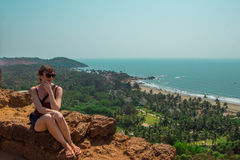 Young woman in North Goa, India. Top view of Vagator Beach Stock Image