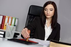 Young woman notary public reaches her stamp royalty free stock photos