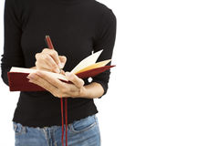 Young woman with a note book. On the white background Royalty Free Stock Photos