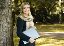 Young woman with notebook Stock Images