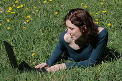 Young woman and notebook. Beauty woman work with notebook in a grass Royalty Free Stock Image