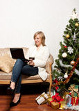 Young woman with a notebook near Christmas tree Royalty Free Stock Photos