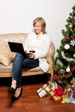 Young woman with a notebook near Christmas tree Stock Images