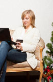 Young woman with a notebook near Christmas tree Royalty Free Stock Image