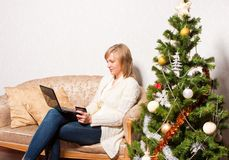 Young woman with a notebook near a fir-tree Royalty Free Stock Photography