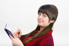 Young woman with a notepad and pen Royalty Free Stock Photo