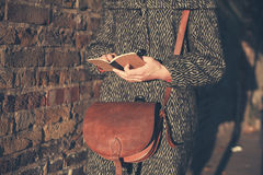 Young woman with notepad at sunset Royalty Free Stock Photography