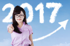 Young woman with numbers 2017 and arrow Stock Photo
