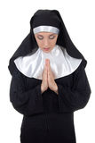 Young woman nun praying isolated on white royalty free stock photo