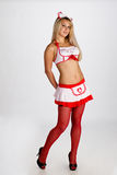 Young woman in nurse outfit Stock Images