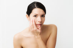 Young woman observing facial wrinkles stock photos