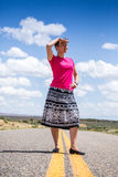 Young woman observing something far away Stock Photo
