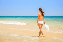 Young woman on ocean beach Royalty Free Stock Image