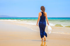 Young woman on ocean beach Stock Photos