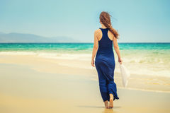 Young woman on ocean beach Stock Photography