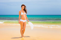 Young woman on ocean beach Royalty Free Stock Photography
