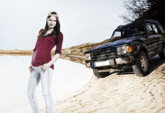 Young woman with off road car on the sand dune Stock Photo