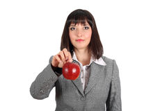 Young woman offer an apple Royalty Free Stock Image