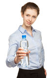Young woman offering bottle of clear water Royalty Free Stock Image