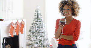 Young woman offering a Christmas toast Stock Images