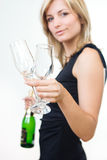 Young woman offering drink Royalty Free Stock Photography