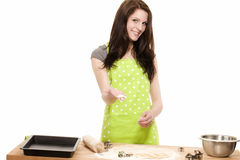 Young woman offering formed christmas dough Stock Photo