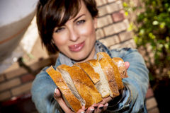 Young woman offering fresh sliced bread Royalty Free Stock Photography