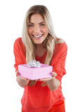 Young woman offering gift Stock Photography